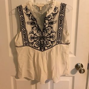 White silk top with black embroidery